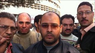 Ahmed Saad (centre) and other protesters outside the state TV in Cairo