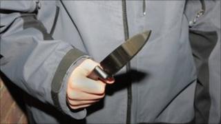 A boy holding a knife