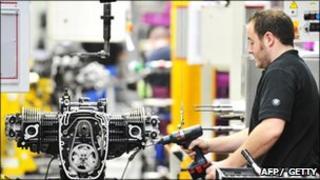 Worker assembles a motorbike