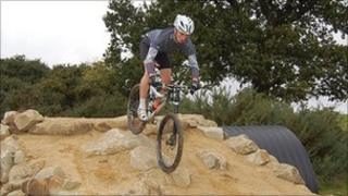 Rider tackling part of the mountain bike course at Hadleigh Farm