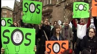 People demonstrating against cuts in Coventry