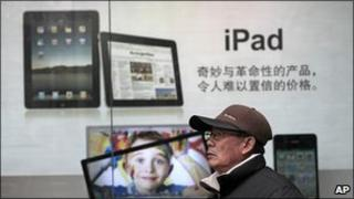 Man walks past iPad advert