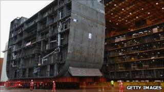 BAE Systems workers assemble part of an aircraft carrier at Govan in Scotland
