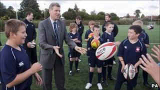 Justice Secretary Kenny MacAskill with young rugby players