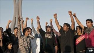Bahrainis shout slogans in Pearl Square, the capital Manama, on Tuesday