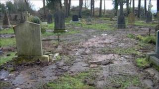 Milltown cemetery with muddy areas