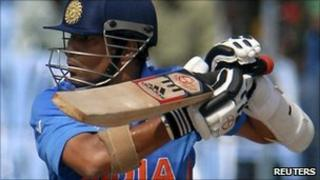 India's Sachin Tendulkar plays a shot during a Cricket World Cup warm-up match against New Zealand