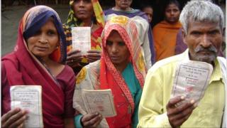 Residents of Pachdeora village show their BPL cards