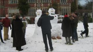 Guests model the bride and groom in the snow