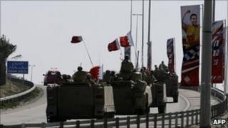 Bahraini armoured vehicles leave the area near Pearl Square - 19 February 2011