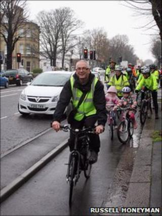 Councillor Ian Davey leads protesters on a ride along The Drive cycle lane to city council offices