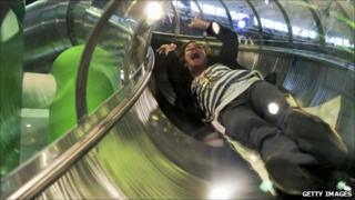 Participant slides down a tube at the Mobile World Congress in Barcelona