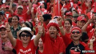 "Thai anti-government ""red shirt"" protesters gestures during a rally at the Democracy monument"