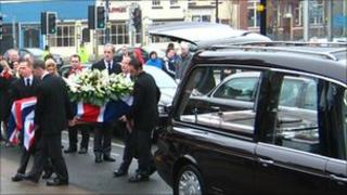 Sam Plank's coffin is taken out of the hearse