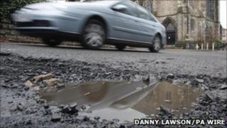 Car and pothole