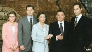 President Hosni Mubarak (2nd right) and his wife Suzanne(centre) pose for a family picture with their two sons Gamal (right) and Alaa (2nd left) and the latter's wife Heidi al-Sakher (left). File photo