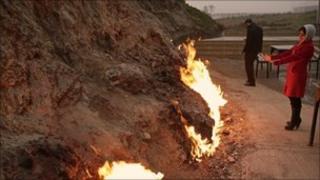 Naturally occurring fires light up a hillside near Baku
