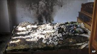 The charred bed of Vietnamese journalist Le Hoang Hung, at his home in southern Long An province, Vietnam, 19 Jan '11