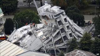 Rescue workers climb onto the collapsed Pyne Gould Guinness Building in central Christchurch, New Zealand, Tuesday, Feb. 22 2011.