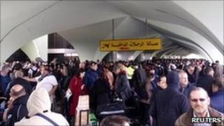 People waiting to be evacuated at the check-in hall at Tripoli airport
