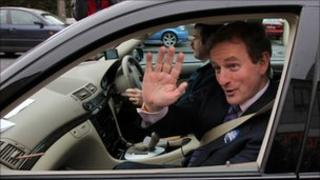 Enda Kenny waving from car window