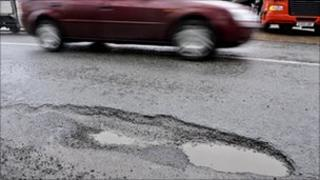 Car drives past pothole in Bristol