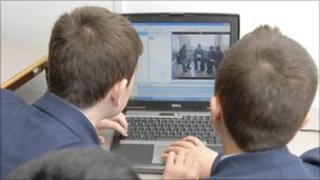 Secondary children on a computer
