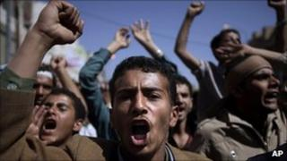 Anti-government protesters chant slogans during a demonstration in Sanaa, Yemen, 23 February 2011