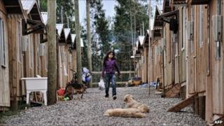 A girl walks on 9 February 2011 amid basic houses in the coastal city of Dichato, 450 km south of Santiago, devastated by the quake and tsunami of 27 February 2010.