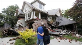 Christchurch residents Murray and Kelly James look at their destroyed house on 23 February 2011