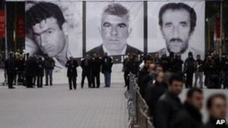Albanian protesters gather under pictures of those killed in the Tirana unrest, 28 January