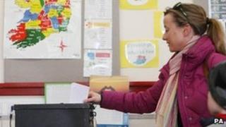 A woman votes in Castlebar, County Mayo, Irish Republic, 25 February