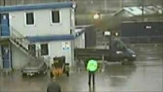 Footage of truck being reversed into building