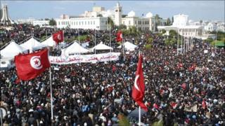 Thousands of Tunisian demonstrators gather near the prime minister's office in Tunis, 25 February 2011