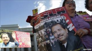 member of the Sandinista Party holds a poster with an image of Nicaragua President Daniel Ortega during the Sandinista Congress at Revolution Square in Managua 26 February, 2011