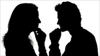 Woman and man in profile