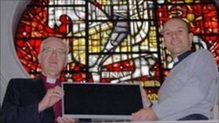 Lord Carey & Revd. Cowan display a PVC panel at the Church