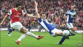 Samir Nasri (left) shoots for goal for Arsenal in the final