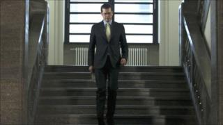 German Defence Minister Karl-Theodor zu Guttenberg arrives to announce his resignation from all political offices in Berlin, March 1, 2011