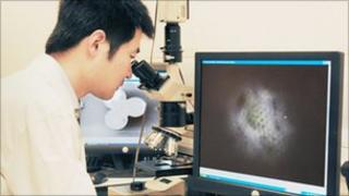 "Wei Guo with ""super-resolution"" microscope"
