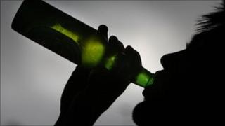 Boy with bottle of beer (generic)