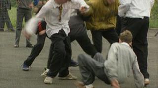 children in school playground bullying