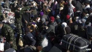 People waiting on Libyan soil to cross into Tunisia
