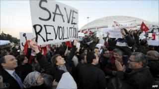 Around 5,000 people rally in Tunis to call on Tunisians to return to work and stop continuing protests, 1 March