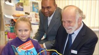 Dr Yemula and Professor Besag with a young reader