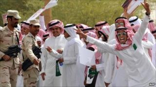 Saudi youth greet the convoy of King Abdullah in Riyadh, 23 February
