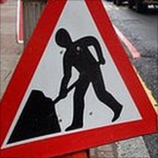 Man at work road sign