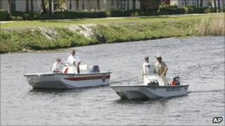 Investigators search the Florida canal