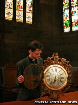 Rev Allan Miller with the clock