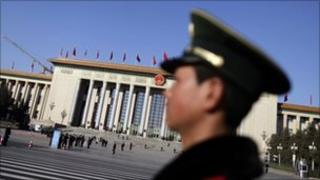 A paramilitary policeman stands guard near the Great Hall of the People, the venue of the National People's Congress or parliament, in Beijing